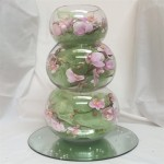 3 tier fish bowl with orchids and sashes