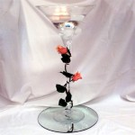 large martini glass with floating candles