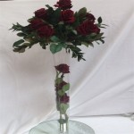 tapered vase with 3 roses. and roses on top